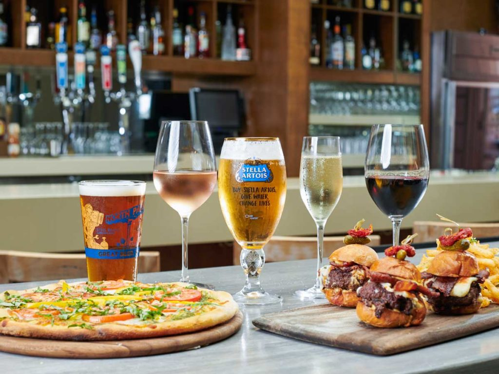 Pizza, beers, and drinks at Happy Hour in San Diego