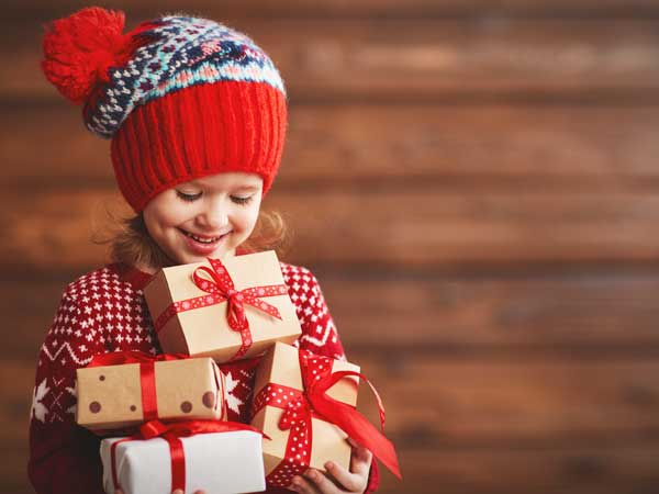 Girl at Christmas with gift boxes